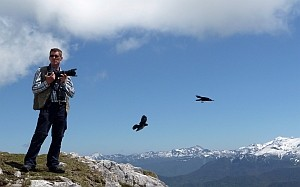 Jeff Clarke photographing Alpine Choughs at the <br />top of the cable car © Val Marshall